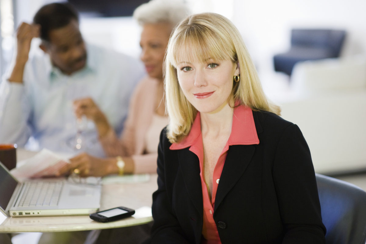 female_planner_with_couple_in_background_2400X1597_shutterstock_121893292 copy